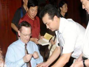 Dr. J. Davidson Frame signing his book