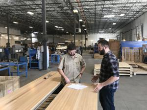 Production Manager, Cody Adams Speaking with Woodshop Supervisor, Phillip Mayes