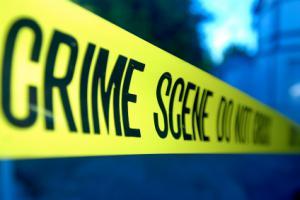 Crime scene tape surrounds a fundraising crime scene