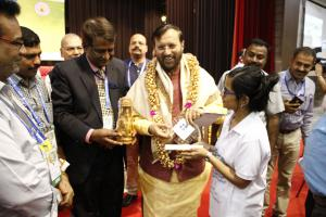 Minister of Human Resource Development in India receiving a memento celebrating the launch of MageQuill in India