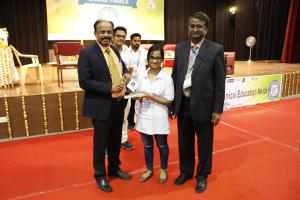 Professor Dileep received a memento and was happy to discuss the ongoing lore competition.