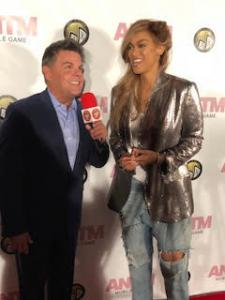 Tyra Banks, television personality, producer, businesswoman, actress, author, who is best know for America's Top Model, talks to Scott on the Red Carpet.