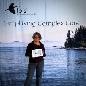 Piali De, Ph.D., CEO of Senscio Systems holds the Ibis tablet that helps monitor an individual's symptoms of COVID-19.