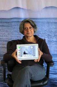 Piali De, Ph.D., CEO of Senscio Systems holding the Ibis tablet.