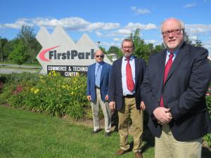 From left to right: Stephen Monsulick, Jr., president of FirstPark, Erik Urbanek, managing director of SVN | The Urbanek Group Advisors and Jim Dinkle, executive director of FirstPark take a photo at the entrance to the business park in Oakland.
