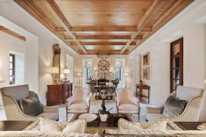 Expertly designed, 2930 Hurlingham Drive's living room boasts views of the courtyard.