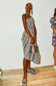 A model wearing a Lola Elan dress at New York Fashion Week