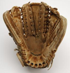 The six-finger glove that Greg A. Harris custom-designed with Mizuno Corporation, a Japanese company founded in 1906 who first marketed baseball gloves.
