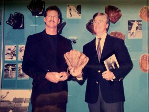 Greg A. Harris with Jeff Idelson, retired President of The Baseball Hall of Fame presenting his six finger glove.