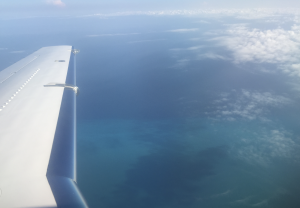 private jet flying to the Caribbean