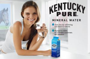 Woman drinking a glass of Kentucky Pure Mineral Water