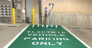 SemaConnect Series 6 EV charging station with cable management system mounted on parking garage wall at Chicago's Deer Park Crossing Apartments