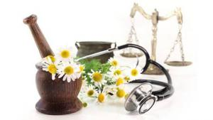 Natural health image with plant, stethoscope and scales