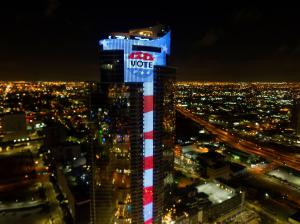 """Early Voting Florida, Largest Electronic U.S. Flag & L.E.D. """"VOTE"""" Button Image Appearing on 700-Foot, 60-Story, $600-Million Paramount Miami Worldcenter, Lighting-Up City's Skyline ( Bryan Glazer 