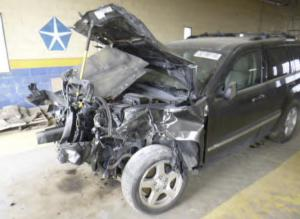 Wrecked SUV in Brain Injury Settlement
