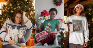 a women sits with a snowman pillow in front of a Christmas tree, while another women enjoys a cup of something hot in her retro designed mug and a gentleman stands with a package wearing a long sleeve tshirt with a 1904 Puck Magazine graphic of Santa Clau