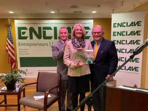 Two men presenting award to a woman, Leslie G. Munger Receives Exemplary Woman Leader 2020 Award from Mayor Craig B. Johnson and Enclave CEO John R. Dallas, Jr.