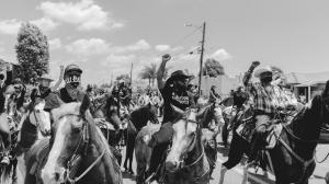 A photo of the Compton Cowboys riding in protest.