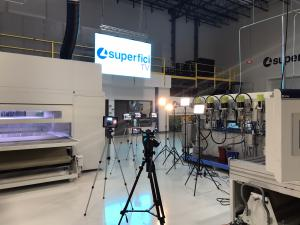 Photograph inside Superfici America's technology center showing TV production cameras and LED wall.