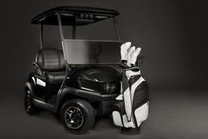 The APEX midsize staff from VESSEL Bags is shown in a black and white colorway. The golf staff bag is modeled with matching golf head covers.