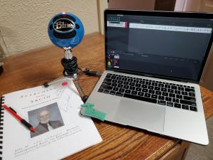 A photograph of a recording setup for Crashed in Roswell podcast featuring ufologist Dennis Balthaser