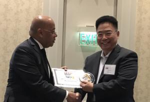 Robert Chen accepts award